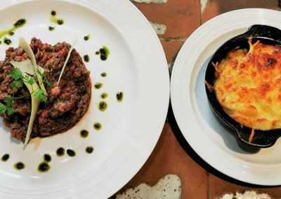 Bouillon Racine, Hand cut beef tartar, Basil, olive oil and citrus, potato gratin